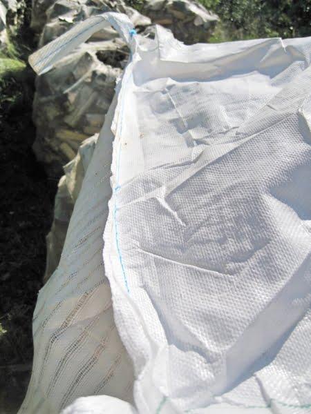 Handtag på Storsäck med regnskydd